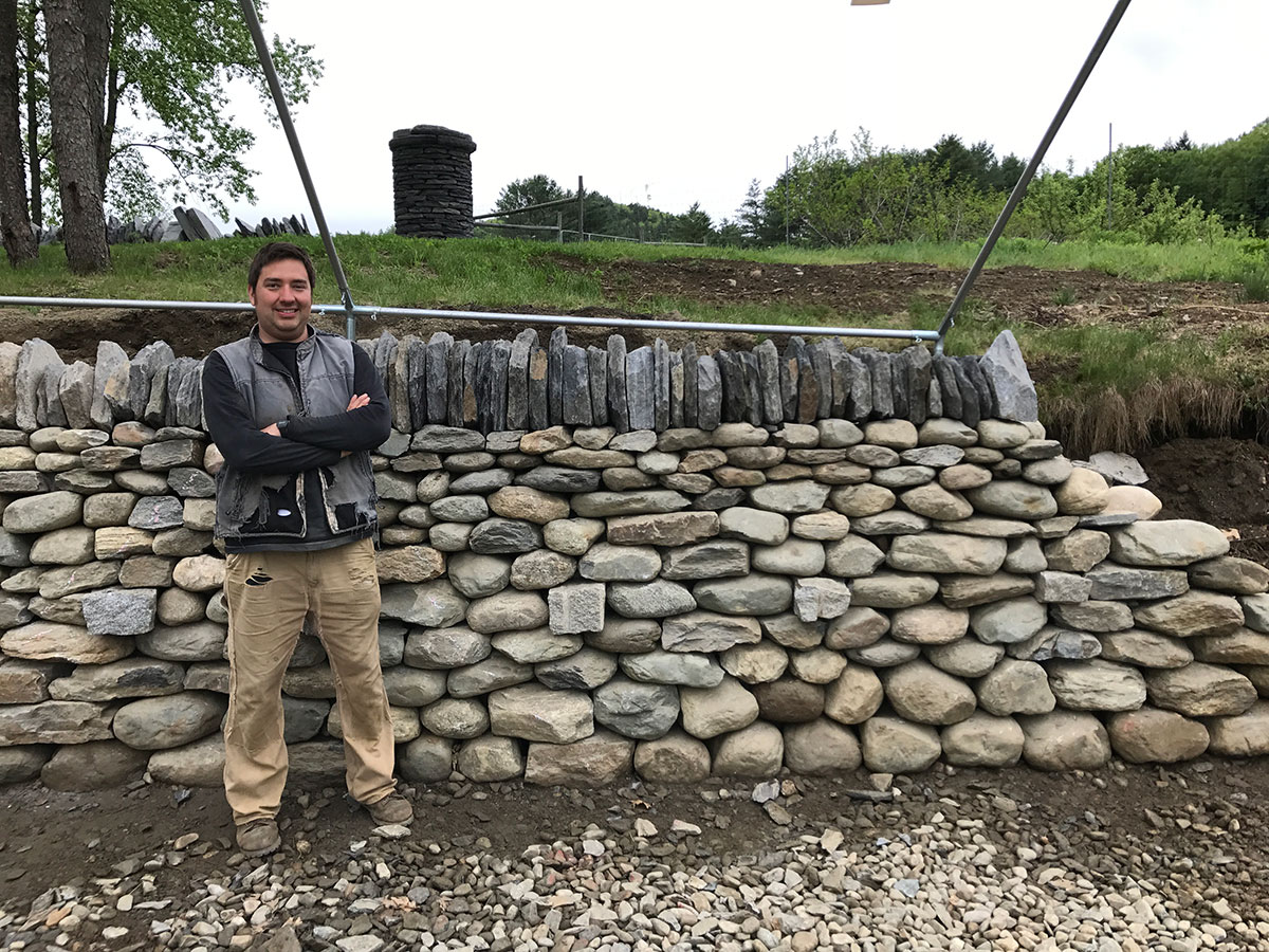Daniel Arabella in front of a Drystone Retaining wall image