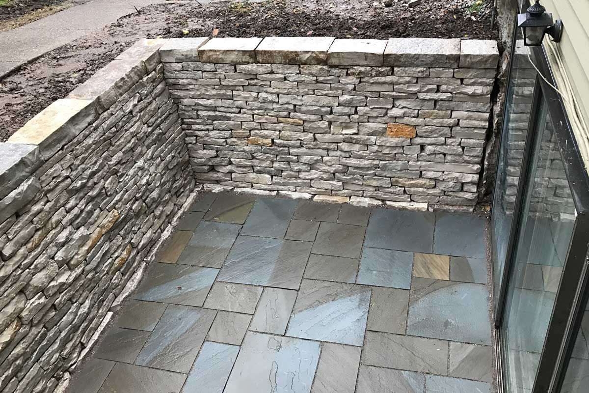 Looking down on Sunken Patio with Drystone Retaining Walls and Natural Stone Patio