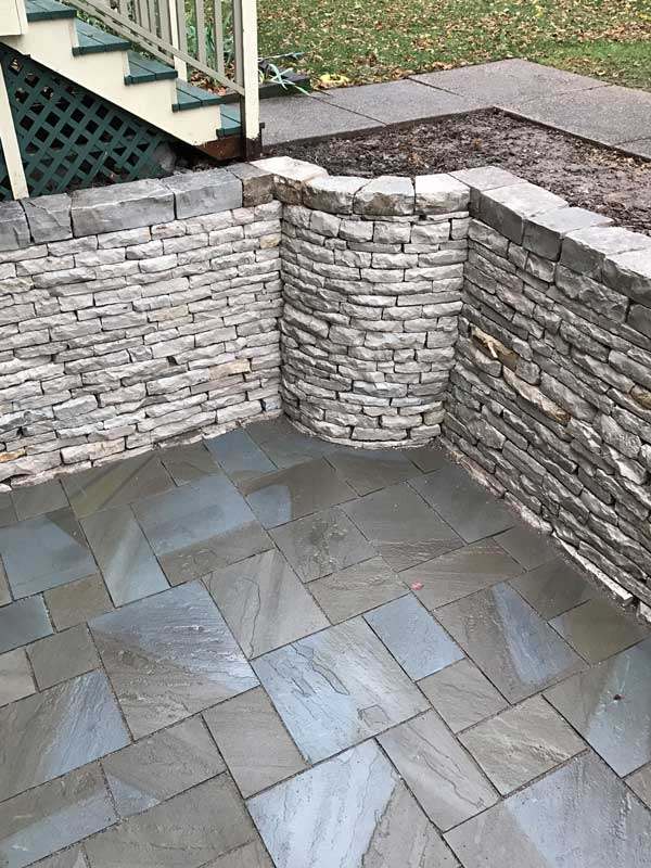 Looking Down on the Curved Fond du Lac Drystone Retaining Wall and Natural Stone Patio