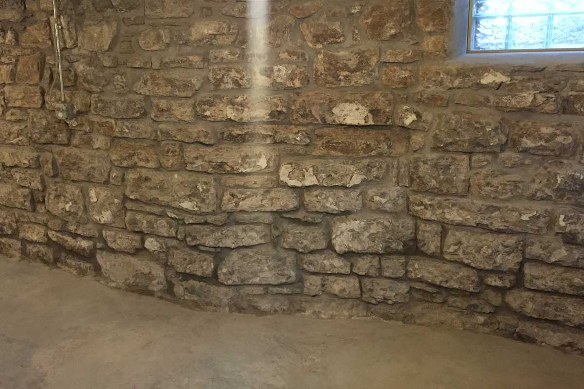 Stone wall restoration in basement