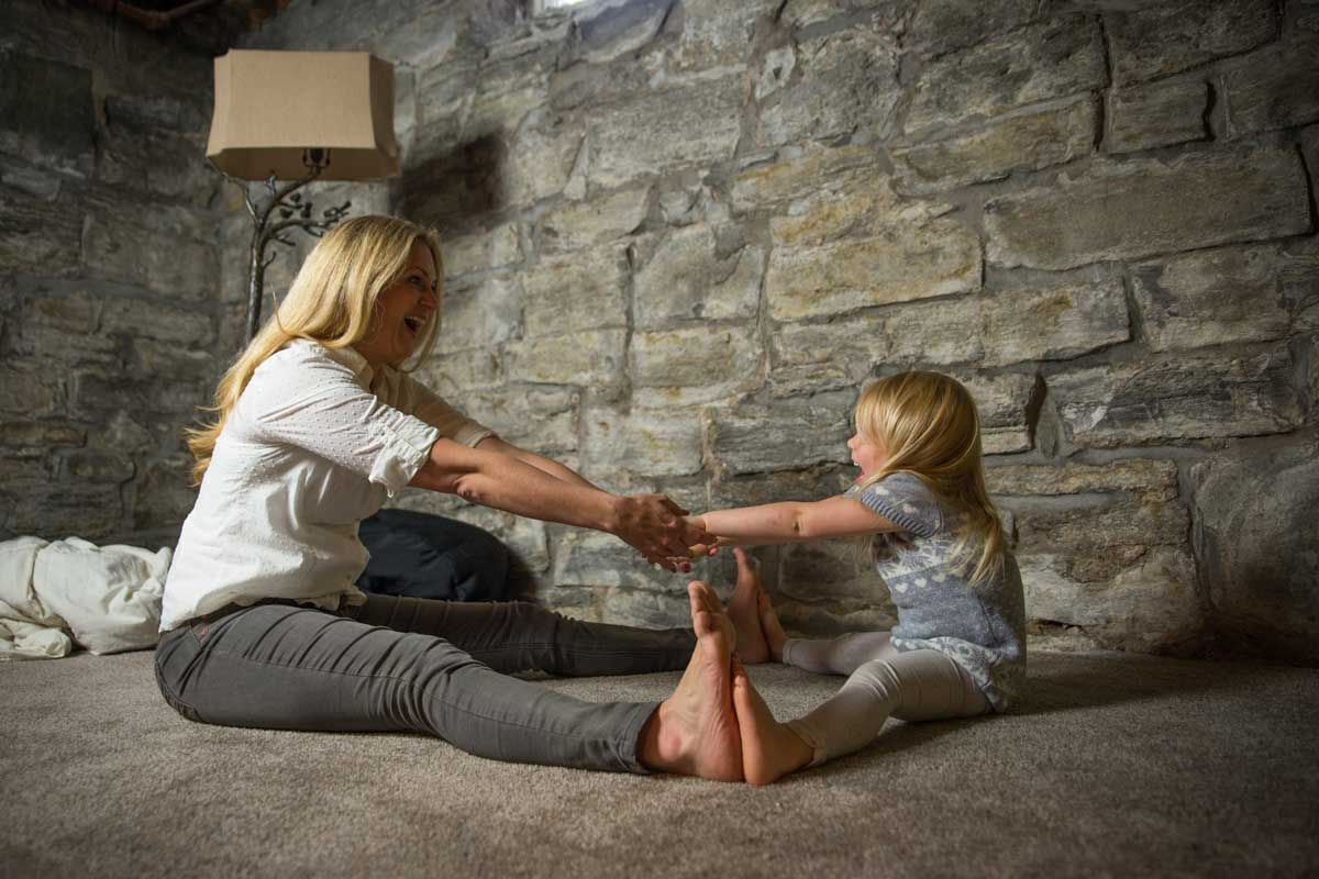 Family in basement with stone wall restoration