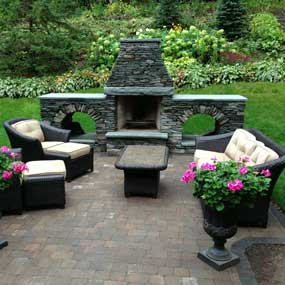 Pleasant Lake Outdoor Living Stone Fireplace and Stone Patio Image